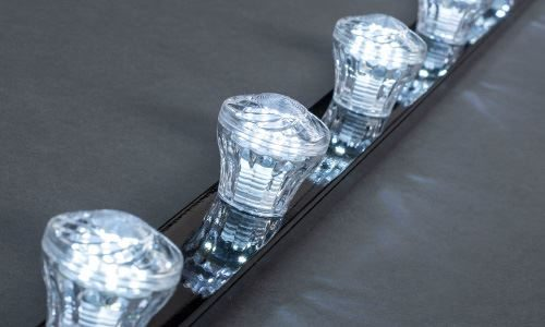 LED fairground cabochon lights in cool white and clear plastic housing